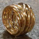 18krt gouden bandring breder model meer banden